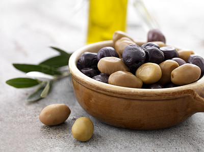 Buy stock photo Closeup of ceramic bowl full of green and dry black olives