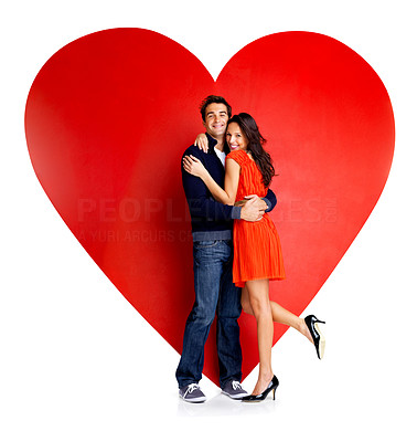 Buy stock photo Beautiful young love couple embracing against a big red heart on white background