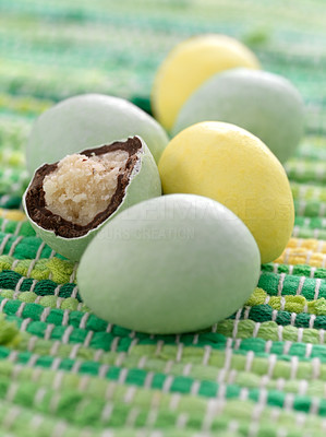 Buy stock photo Delicious easter chocolate eggs on the woven floor carpet