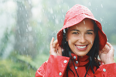 Buy stock photo Woman smiling outdoors in rainy weather