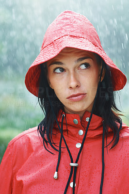 Buy stock photo Woman pondering while standing outside in rain