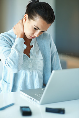Buy stock photo Woman with stiff neck looking at laptop
