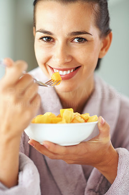 Buy stock photo Smiling woman holding bowl of fruits