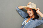 Cowgirl smiling while holding hat