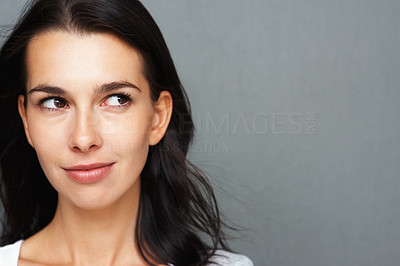 Buy stock photo Closeup of woman slightly smiling while looking to the side