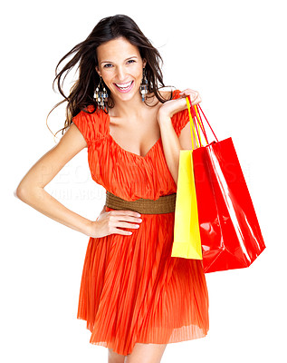 Buy stock photo Portrait of smiling young woman holding colourful shopping bags against white background