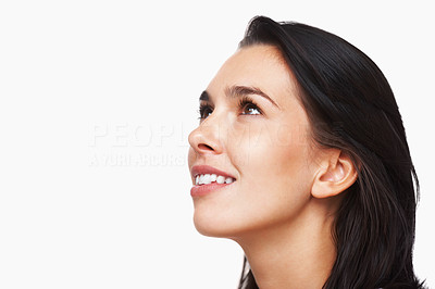Buy stock photo Closeup of isolated young woman looking up on white background