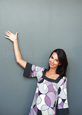 Buy stock photo Pretty woman smiling with arm against background