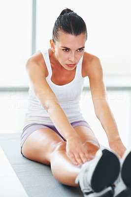 Buy stock photo Portrait of active young female doing stretching exercise on mat