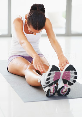 Buy stock photo Active young woman doing stretching exercise on mat
