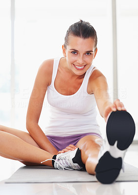 Buy stock photo Portrait of smiling young woman stretches her leg
