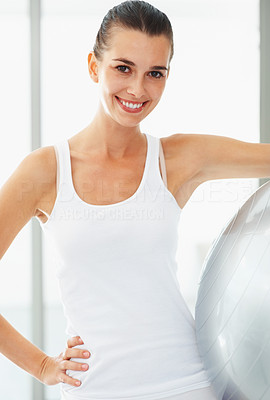 Buy stock photo Portrait of pretty young woman holding fitness ball