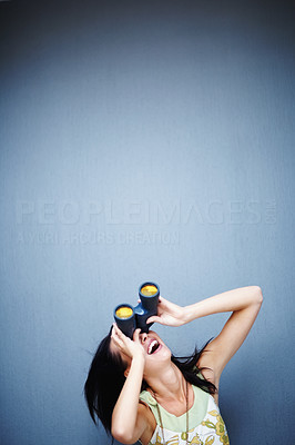 Buy stock photo Excited young woman with binoculars looking at copyspace