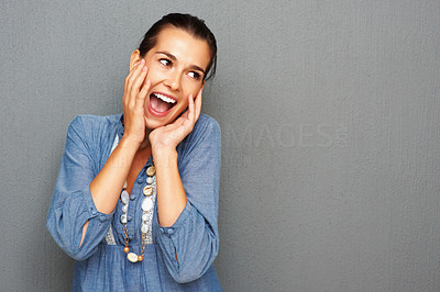 Buy stock photo Portrait of surprise woman holding her face against wall