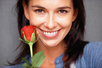 Buy stock photo Closeup of beautiful young woman with red rose smiling