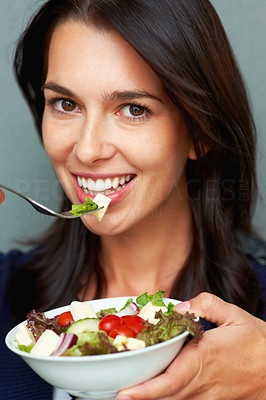 Buy stock photo Closeup of pretty young woman eating fruit salad