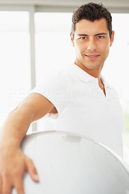 Buy stock photo Portrait of confident young man with exercise ball