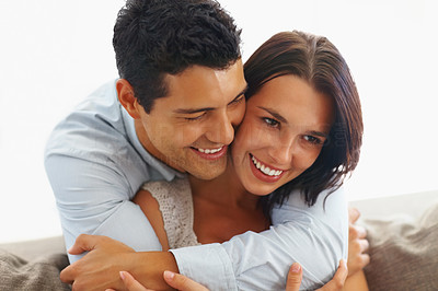 Buy stock photo Portrait of young man hugging his girlfriend from behind