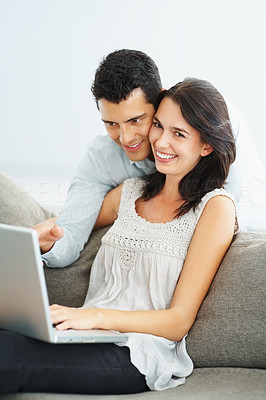 Buy stock photo Portrait of young couple working together on laptop