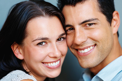 Buy stock photo Closeup portrait of attractive young couple smiling together