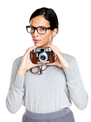 Buy stock photo Pretty young female in glasses holding a camera in hand against white background