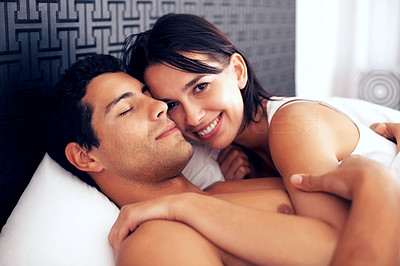 Buy stock photo Portrait of young couple lying on bed