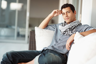 Buy stock photo Portrait of young man relaxing on couch while looking at you