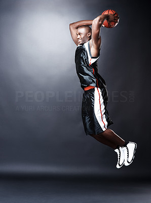Buy stock photo Portrait of a young afroamerican making a dunk shot against grunge background