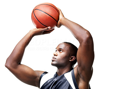 Buy stock photo Portrait of a successful young male basketball player taking free throw against white background