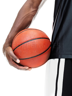 Buy stock photo Cropped image of a young basketball player holding the ball against white background