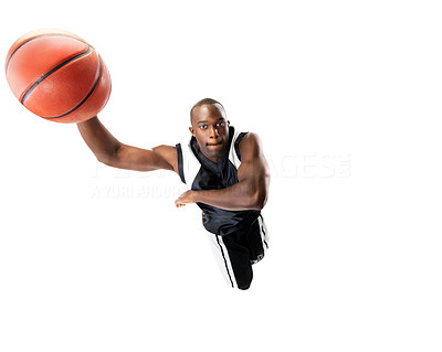 Buy stock photo Portrait of a young male basketball player jumping in air trying to dunk the ball