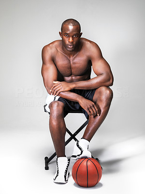 Buy stock photo Portrait of a relaxed african american basketball player sitting on stool over white background