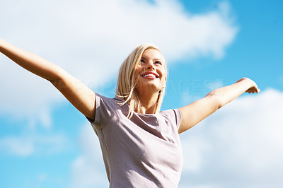 Buy stock photo Young beautiful woman with arms open on sunny day