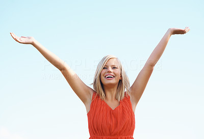Buy stock photo Portrait of happy woman with arms open enjoying the summer