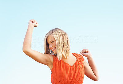 Buy stock photo Cheerful young woman dancing outdoors on sunny day