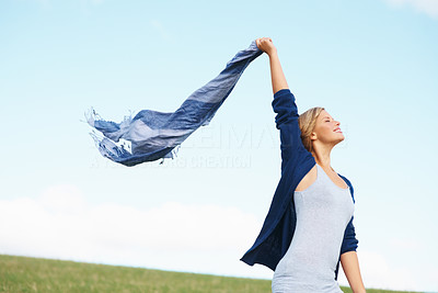 Buy stock photo Happy teenage woman holding scarf in wind