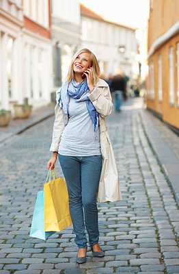 Buy stock photo Urban view of shopping woman on phone