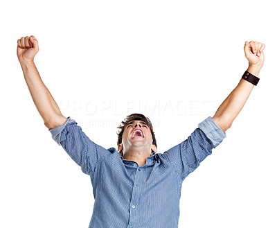 Buy stock photo Portrait of an excited young man celebrating victory on white background