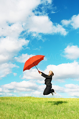 Buy stock photo Portrait of business woman jumping in grassland with red umbrella