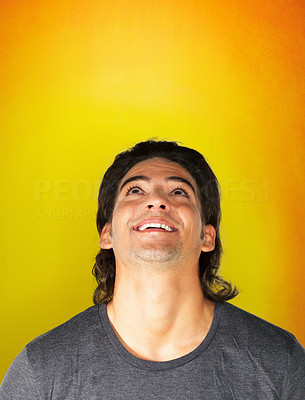 Buy stock photo Handsome man looking straight up and smiling
