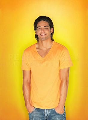 Buy stock photo Handsome man wearing yellow t-shirt against yellow background with hands in pocket