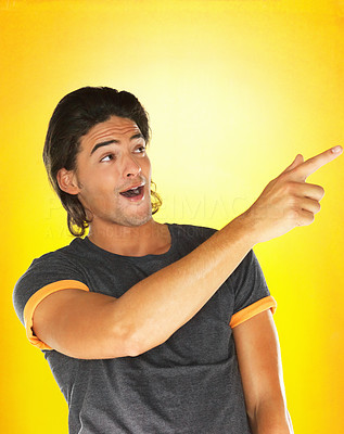 Buy stock photo Handsome man pointing  with surprised look