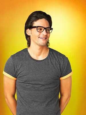 Buy stock photo Casual man wearing glasses and standing with arms behind back