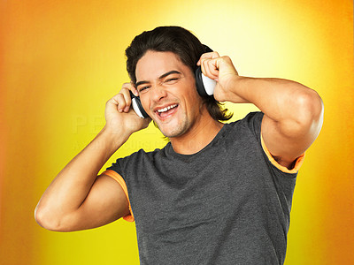 Buy stock photo Man singing while listening to headphones