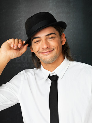 Buy stock photo Handsome man holding brim of hat while winking