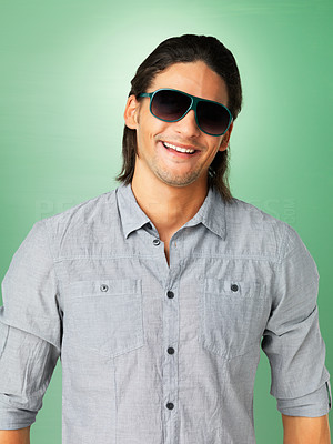 Buy stock photo Handsome man smiling while wearing sunglasses