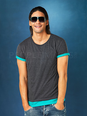 Buy stock photo Handsome man with hands in pocket and wearing sunglasses