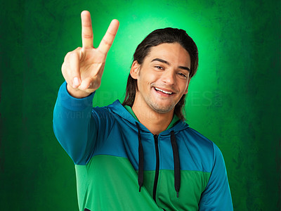 Buy stock photo Casually dressed man giving peace sign