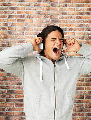 Buy stock photo Man yelling while listening to headphones