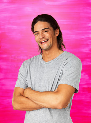 Buy stock photo Handsome man dressed casually with his arms folded against pink background
